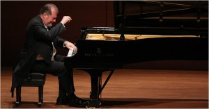 "Ohlsson soloed in both the third piano concerto and the ""Choral Fantasy"""
